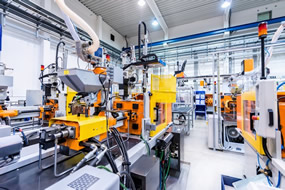 The inside of an industrial factory with automated machinery