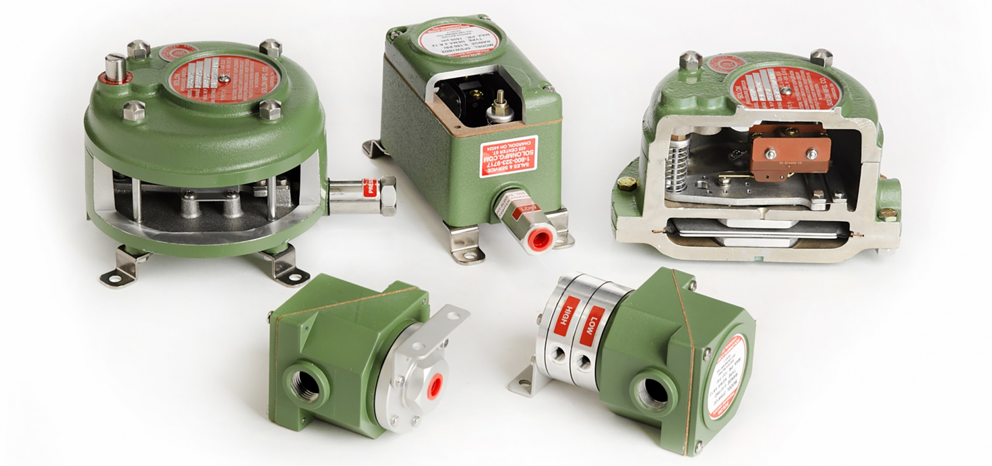 A group of green catalog pressure switches